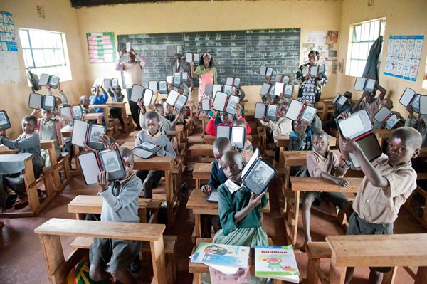 Kenya-Classroom-holding-up-ereaders-World-Reader.jpg