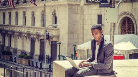 20150701170930-surveyed-choose-entrepreneurship-despite-sacrifices-black-male-computer-laptop-working-outside-wall-street.jpeg